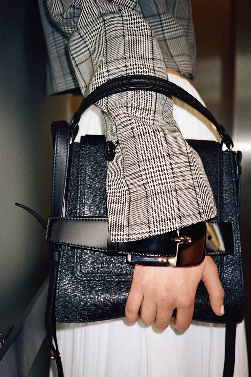 Image of Model holding the Pre-Spring 2020 buckle bag